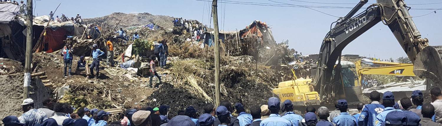 Police officers secure the perimeter at the scene of a garbage landslide, as excavators aid rescue efforts, on the outskirts of the capital Addis Ababa, Ethiopia Sunday, March 12, 2017. Officials and residents say more than a dozen people have been killed in a landslide at a massive garbage dump on the outskirts of Ethiopia's capital, and several dozen people are missing. (Photo Elias Meseret   AP )