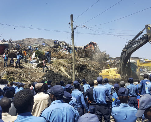Police officers secure the perimeter at the scene of a garbage landslide, as excavators aid rescue efforts, on the outskirts of the capital Addis Ababa, Ethiopia Sunday, March 12, 2017. Officials and residents say more than a dozen people have been killed in a landslide at a massive garbage dump on the outskirts of Ethiopia's capital, and several dozen people are missing. (Photo Elias Meseret | AP )
